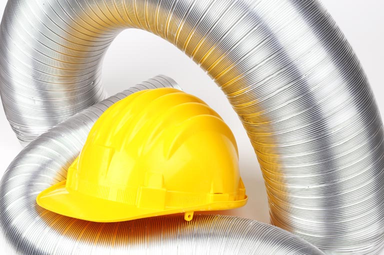 aluminum ducts and yellow construction helmet